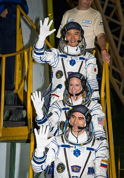 A picture with astronauts waving farewell